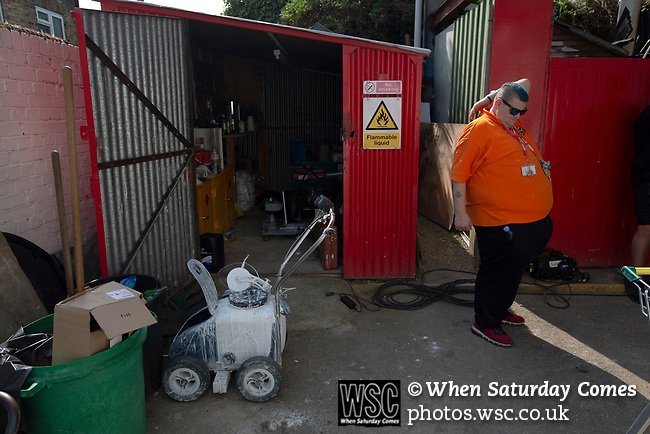 A member of staff with pitch marking equipment in a shed behind the Braemar Road stand pictured before Brentford hosted Leeds United in an EFL Championship match at Griffin Park. Formed in 1889, Brentford have played their home games at Griffin Park since 1904, but are moving to a new purpose-built stadium nearby. The home team won this match by 2-0 watched by a crowd of 11,580.