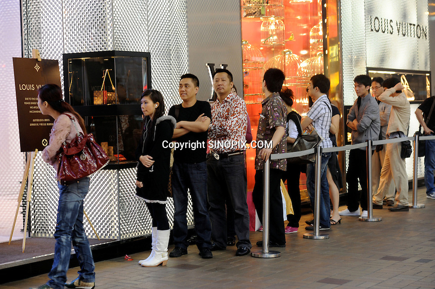 Mainland Chinese consumers line up outside a Louis Vuitton shop on Canton Road, the largest in Hong Kong. Outbound tourists from mainland China spent some $42 billion overseas (including Hong Kong, Macau and Taiwan) last year, outspending inbound international tourists for the first time. Hong Kong, is a leading destination for mainland tourists and is leading centre for luxury fashion brands carry the complete range of one of the world's top fashion brands products...