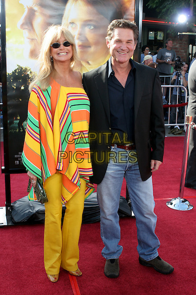 "GOLDIE HAWN & KURT RUSSELL.Los Angeles Premiere of ""Dreamer"" held at the Mann Village Theater.9th October 2005.Ref:ADM/ZL.full length yellow orange red green stripe stripes stripey striped off the shoulder poncho slim skinny trousers sunglasses shades navy black suit jacket shirt denim jeans with together celebrity couple .www.capitalpictures.com.sales@capitalpictures.com.©Zach Lipp/AdMedia/Capital Pictures."