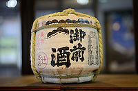 "Sake barrel marked ""Gozenshu"" (Tsuji Honten's best known brand). Tsuji Honten Sake, Katsuyama town, Okayama Prefecture, Japan, January 31, 2014. Tsuji Honten was founded in 1804 and has been at the cultural centre of the town of Katsuyama for over two centuries. 34-year-old Tsuji Soichiro is the 7th generation brewery owner. His elder sister, Tsuji Maiko, is the ""toji"" master brewer."