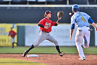 Mississippi Braves shortstop Dansby Swanson (5) fields the ball and starts the turn on a double play over a hard sliding Billy McKinney (4) during a game against the Tennessee Smokies at Smokies Stadium on May 7, 2016 in Kodak, Tennessee. The Smokies defeated the Braves 5-3. (Tony Farlow/Four Seam Images)