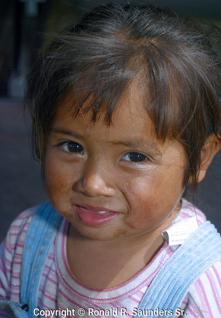 Cute street urchin smiles for camera