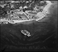 BNPS.co.uk (01202 558833)<br /> Pic: Aerofilms/HistoricEngland/BNPS<br /> <br /> Studland Ferry, 24 September 1947 - before the area became 'Millionaires Row'<br /> <br /> Stunning historic aerial photos of seaside towns, naval bases, ports and shipyards which tell the story of Britain's once-great maritime tradition feature in a new book.<br /> <br /> The fascinating archive of black and white images includes views from a bygone age such as Brighton's famous West Pier, Grimsby's burgeoning fishing fleet, and London's dock yards.<br /> <br /> Iconic ships were also captured from the skies including the Cutty Sark in its final seaworthy years on the Thames, HMY Britannia in 1959, the RMS Queen Mary in 1946 and the SS Queen Elizabeth in 1969 about to make her maiden voyage.<br /> <br /> England's Maritime Heritage from the Air, by Peter Waller, is published by English Heritage and costs &pound;35.