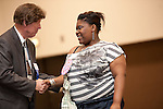 Associated Masonry Contractors of Houston Award winner, Berneria Wyatt receives congratulations from Steve Mead at the 2011 Aldine Scholarship Foundation Scholarship Ceremony at Lone Star College - North Harris.