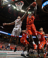 Clemson center Sidy Djitte (50) grabs the rebound next to Virginia forward Isaiah Wilkins (21) during an ACC basketball game Tuesday Jan. 19, 2016, in Charlottesville, Va. (Photo/Andrew Shurtleff)