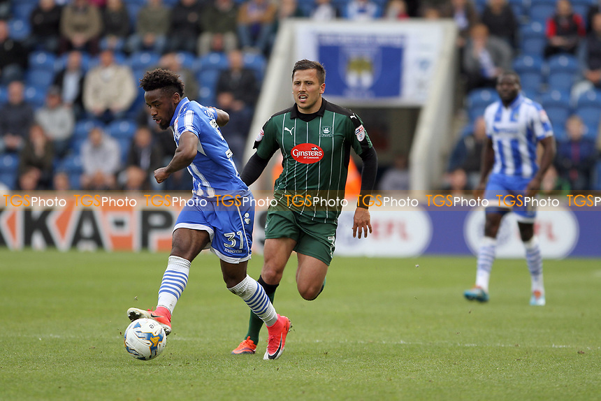 Tariqe Fosu of Colchester United runs with the ball during Colchester United vs Plymouth Argyle, Sky Bet EFL League 2 Football at the Weston Homes Community Stadium on 22nd April 2017