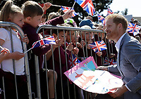 14 May 2019 - Prince Harry Duke of Sussex, meets children in the crowd as he arrives for a visit to Barton Neighbourhood Centre in Oxford. The centre is a hub for local residents which houses a doctor's surgery, food bank, cafe and youth club. Photo Credit: ALPR/AdMedia
