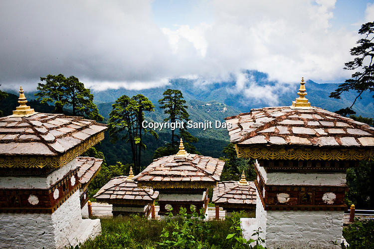 A view from the top of the Dochu La (mountain pass) on the way to Punakha, Bhutan. Dochu La has become a major tourist attraction because of its 108 stupas on the pass. Photo: Sanjit Das/Panos