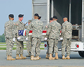 A member of the United States Army transfer team salutes as the transfer case containing the remains of Staff Sergeant Michael H. Ollis, U.S. Army, are loaded into a transfer van during a Dignified Transfer ceremony at Dover AFB in Dover, Delaware on Saturday, August 31, 2013.  Ollis died supporting Operation Enduring Freedom in Afghanistan.<br /> Credit: Ron Sachs / CNP<br /> (RESTRICTION: NO New York or New Jersey Newspapers or newspapers within a 75 mile radius of New York City)