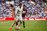 Gareth Bale of Real Madrid battles for the ball with Fran Rico of SD Eibar during their La Liga match between Real Madrid CF and SD Eibar at the Santiago Bernabéu Stadium on 02 October 2016 in Madrid, Spain. Photo by Diego Gonzalez Souto / Power Sport Images