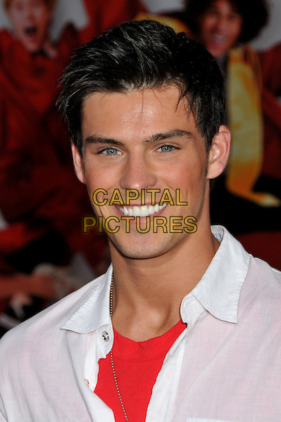 """ADAM GREGORY .""""High School Musical 3: Senior Year"""" Los Angeles Premiere at the USC Galen Center, Los Angeles, California .16 October 2008 .portrait headshot red white shirt collar teeth smiling .CAP/ADM/BP.©Byron Purvis/Admedia/Capital PIctures"""