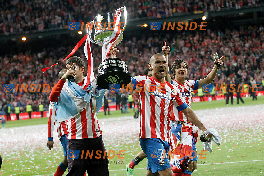 Atletico de Madrid's Cata Diaz (c) and Oliver Torres celebrate the victory in spanish KIng's Cup Final match.May 17,2013. (ALTERPHOTOS/Acero) .Madrid 17/5/2013 .Football Calcio 2012/2013.Finale Coppa del Re Spagna.Foto Alterphotos / Insidefoto .ITALY ONLY