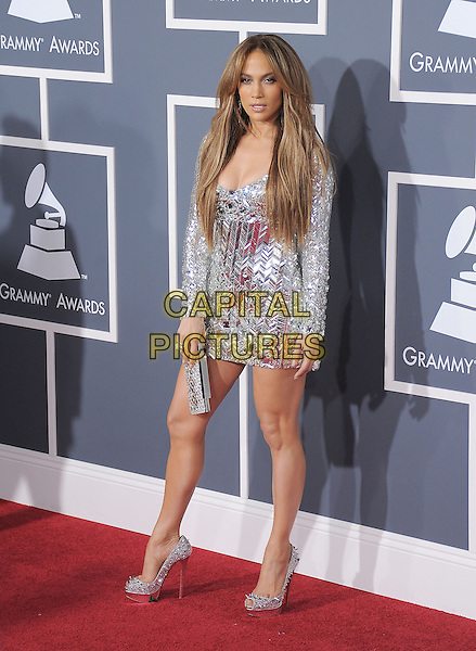 JENNIFER LOPEZ.attending The 53rd Annual GRAMMY Awards held at The Staples Center in Los Angeles, California, USA,.February 13th 2011..arrivals grammys full length silver shiny embellished beaded shiny mini dress long sleeve platform shoes clutch bag .CAP/RKE/DVS.©DVS/RockinExposures/Capital Pictures.