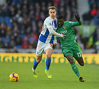 Watford's Ken Sema (right) is tackled by  Brighton & Hove Albion's Solly March (left) <br /> <br /> Photographer David Horton/CameraSport<br /> <br /> The Premier League - Brighton and Hove Albion v Watford - Saturday 2nd February 2019 - The Amex Stadium - Brighton<br /> <br /> World Copyright © 2019 CameraSport. All rights reserved. 43 Linden Ave. Countesthorpe. Leicester. England. LE8 5PG - Tel: +44 (0) 116 277 4147 - admin@camerasport.com - www.camerasport.com