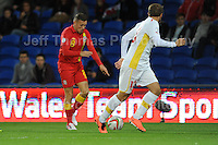 Cardiff City Stadium, Friday 11th Oct 2013. Craig Bellamy of Wales battles with Stefan Ristovski of Macedonia during the Wales v Macedonia FIFA World Cup 2014 Qualifier match at Cardiff City Stadium, Cardiff, Friday 11th Oct 2014. All images are the copyright of Jeff Thomas Photography-07837 386244-www.jaypics.photoshelter.com
