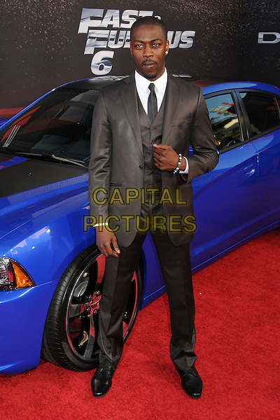 """David Ajala.""""Fast & Furious 6"""" Los Angeles Premiere held at the Universal Gibson Amphitheatre, Universal City, California, USA..May 21st, 2013.full length black suit brown.CAP/ADM/BP.©Byron Purvis/AdMedia/Capital Pictures"""