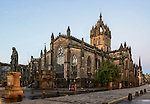 St. Giles Cathedral, on the Royal Mile, Edinburgh, at sunrise, together with the statue of Adam Smith (at left)