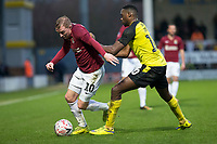 5th January 2020; Pirelli Stadium, Burton Upon Trent, Staffordshire, England; English FA Cup Football, Burton Albion versus Northampton Town; Nicholas Adams of Northampton Town being held back be Lucas Akins of Burton Albion  - Strictly Editorial Use Only. No use with unauthorized audio, video, data, fixture lists, club/league logos or 'live' services. Online in-match use limited to 120 images, no video emulation. No use in betting, games or single club/league/player publications