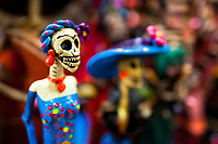Calaca figurines are sold on the market during the Day of the Dead holiday in Mexico City, Mexico, 29 October 2016. Skulls, skeletons and the other death symbols are used to adorn graves, altars and offerings during the Day of the Dead (Día de Muertos). A syncretic religious holiday, combining the death veneration rituals of the ancient Aztec culture with the Catholic practice, is celebrated throughout all Mexico. Based on the belief that the souls of the departed may come back to this world on that day, people gather at the gravesites in cemeteries, praying, drinking and playing music, to joyfully remember friends or family members who have died and to support their souls on the spiritual journey.