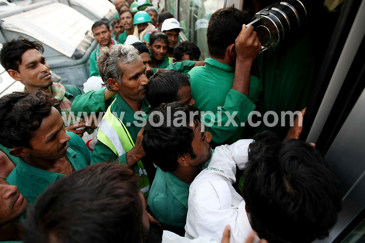 "**ALL ROUND PICTURES FROM SOLARPIX.COM**.**WORLDWIDE SYNDICATION RIGHTS**.Labourers  battle against each other as they try and  get on a bus to take them home in Abu Dhabi, United Arab Emirates. A report out today (20 May 2009) on the Exploitation of Migrant Workers on Saadiyat Island, Abu Dhabi, was launched at a  press conference in Abu Dhabi by the Human Rights Watch based in New York ..The Louvre and Guggenheim museums are failing to ensure that workers are not being exploited at their sites in Abu Dhabi, the report claimed. It found widespread abuse and a system of ""enforced labour"" in place. 20 May 2009..This pic: Labourers in Abu Dhabi..JOB REF: 9059 DBL     DATE: 20_05_2009.**MUST CREDIT SOLARPIX.COM OR DOUBLE FEE WILL BE CHARGED**.**ONLINE USAGE FEE GBP 50.00 PER PICTURE - NOTIFICATION OF USAGE TO PHOTO @ SOLARPIX.COM**.**CALL SOLARPIX : +34 952 811 768 or LOW RATE FROM UK 0844 617 7637**"