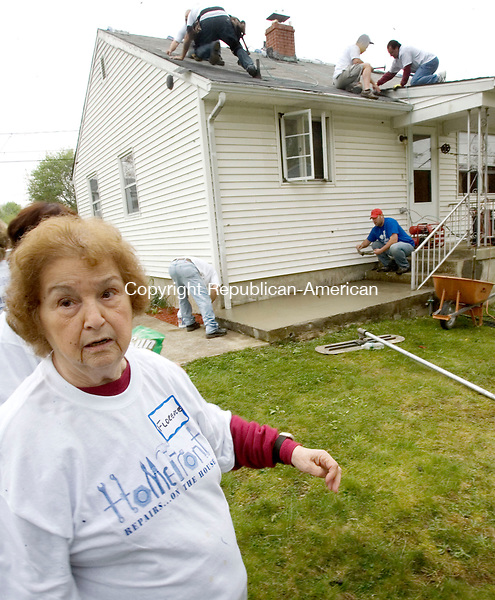 WATERTOWN, CT. 05 May 2012-050512SV04-Florence Lucchetti, 91 of Watertown watches as volunteers work on her home in Watertown Saturday. The Americares HomeFront program returns for its yearly home improvement blitz. Volunteers from St. Mary Magdalen Church in Oakville coordinated the effort..Steven Valenti Republican-American