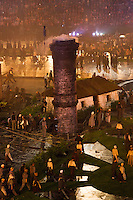 "27 JUL 2012 - LONDON, GBR - A chimney rises through the ""Green and Pleasant Land"" set during the ""Pandemonium"" section of the Opening Ceremony of the London 2012 Olympic Games in the Olympic Stadium in the Olympic Park, Stratford, London, Great Britain (PHOTO (C) 2012 NIGEL FARROW)"