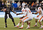 Washington Huskies quarterback Keith Price looks to scramble against the Oregon State Beavers Scott Crichton (95), Rudolf Fifita (78) and Rusty Fernando (56) at CenturyLink Field in Seattle, Washington on October 27, 2012.  Price completed 18 of 30 passes and had one intercepted in the Huskies upset 20-17 win over the 7th ranked Beavers . ©2012. Jim Bryant Photo. ALL RIGHTS RESERVED.