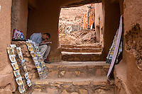 Morocco.  Vendor Hoping to Sell Postcards and Art Work.  Ait Benhaddou Ksar, a World Heritage Site.