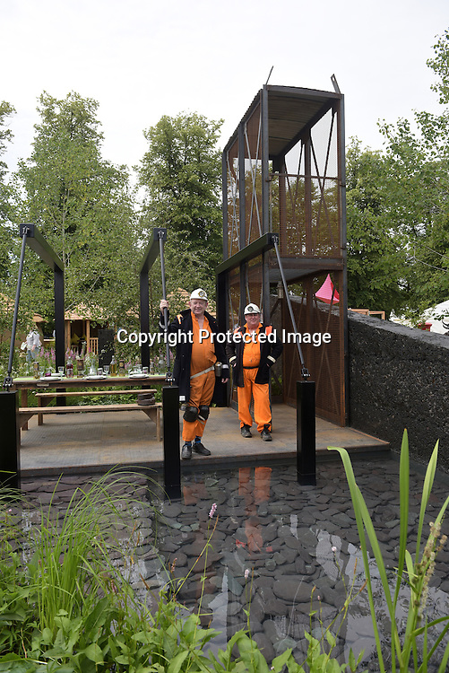 Hadlow College &quot;green Seam&quot; garden had guests of honours - two miners celebrating East Kent's mining heritage at the RHS Hampton Court Flower show. <br /> <br /> Bethany Clarke / RHS / London 29.6.15