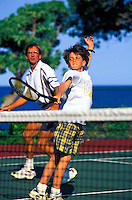 Father and son playing tennis on  vacation on the Big Island of Hawaii
