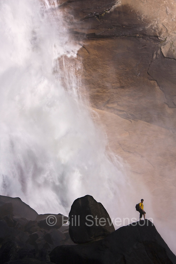 A man hiking in Yosemite National Park by Nevada Falls in California