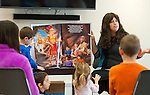 PROSPECT,  CT-122716JS01-- Dini Druk, of Woodbridge, reads If the Candles Could Speak; The Story of Chanukah by Dassie Prus, during Hanukkah story hour Tuesday at the Prospect Public Library. The program included Hanukkah stories, Menorah lighting, Hanukkah sing-along and Hanukkah crafts. <br /> Jim Shannon Republican-American