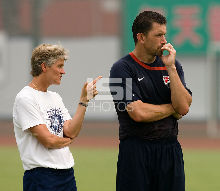USWNT head coach Pia Sundhage talks with goalkeeper coach Phil Wheddon while practicing at Beijing Normal University in Beijing, China.  The team will now move to Qinhuangdao to prepare for their first two group games of the 2008 Olympics.