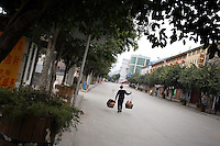 CHINA. Chongqing Province.  A man carrying goods in a town along the Yangtze river that will be partially flooded by the 3 Gorges Dam. The flooding of the three Gorges, by damming the Yangtze near the town of YiChang, has remained a controversial subject due to the negative environmental consequences and the displacement of millions of people in the flood plain. The Yangtze River however is reported to be at its lowest level in 150 years as a result of a country-wide drought. It is China's longest river and the third longest in the world. Originating in Tibet, the river flows for 3,964 miles (6,380km) through central China into the East China Sea at Shanghai.  2008.