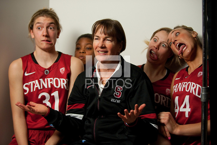 DENVER, CO--Toni Kokenis, Amber Orrange, Lindy LaRocque and Joslyn Tinkle have fun with the cameras and Head Coach Tara VanDerveer during media day at the Pepsi Center for the 2012 NCAA Women's Final Four in Denver, CO.