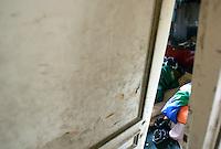 Rifugiati somali nell'ex ambasciata di Somalia a Roma, 29 dicembre 2010..Circa 200 rifugiati somali vivono in condizioni igieniche precarie nell'edificio che ospitava l'ambasciata e che e' stato abbandonato dopo la caduta del governo somalo negli anni Novanta..A Somalian refugee sleeps inside the former Somalian embassy in Rome, 29 december 2010. About 200 refugees live  in precarious hygienic conditions in the building, which is still the property of the Somali government but was abandoned after the collapse of the government in Mogadishu in the 1990s..© UPDATE IMAGES PRESS/UPDATE IMAGES PRESS/Riccardo De Luca
