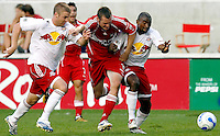 Chicago Fire forward Nate Jaqua (11) tries to get past New York Red Bull defenders Jeff Parke (23, left) and Marvell Wynne (2, right).  The Chicago Fire defeated the New York Red Bulls 2-1 at Toyota Park in Bridgeview, IL on September 3, 2006..