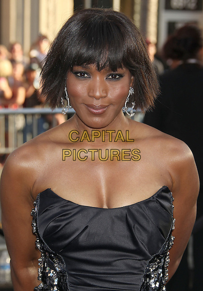 "Angela Bassett.""Green Lantern"" Los Angeles Premiere held at Grauman's Chinese Theatre, Hollywood, California, USA, .15th June 2011..half length strapless black cleavage  earrings .CAP/ADM/RE.©Russ Elliot/AdMedia/Capital Pictures."