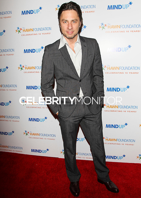 BEVERLY HILLS, CA, USA - NOVEMBER 21: Zach Braff arrives at Goldie Hawn's Inaugural 'Love In For Kids' Benefiting The Hawn Foundation's MindUp Program held at Ron Burkle's Green Acres Estate on November 21, 2014 in Beverly Hills, California, United States. (Photo by Celebrity Monitor)