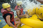 TURRIALBA, COSTA RICA- JANUARY 2, 2009:  Glenn Sáenz (R), 23, of Jersey City; and his cousin Gaby Quirós (L), 21, of San Jose; white-water raft on the Pacuare River with Rios Tropicales on January 2, 2009 in Turrialba, Costa Rica.    (Photo by Michael Nagle)