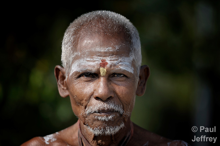 A Hindu holy man in Madurai, a city in Tamil Nadu state in southern India. His face is marked with religious markings.