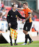 St Johnstone v Dundee United...19.04.14    SPFL<br /> Paul Paton apologises to the asst ref after standing on hime<br /> Picture by Graeme Hart.<br /> Copyright Perthshire Picture Agency<br /> Tel: 01738 623350  Mobile: 07990 594431