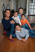 Kristina and Nicholas Krump and their boys, Jackson, 9 (stripes) Ellis, 7(red and white) and Evan, 5 (orange) at their Phoenix home.
