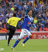 BOGOTA - COLOMBIA- 05 -05-2013: Rafael Robayo  jugador de Millonarios  celebra su gol  contra    Patriotas de Boyacá  partido en el estadio El Campín de la ciudad de Bogotá, mayo 5  de 2013. partido por la  fecha catorce  de la Liga Postobon I. (Foto: VizzorImage / Felipe Caicedo / Staff).   Rafael Robayo  Millonarios player celebrates his goal against Boyacá Patriots game at El Campin in Bogota, May 5, 2013. fourteen date match the I League Europa League. .  (Foto: VizzorImage / Felipe Caicedo / Staff).