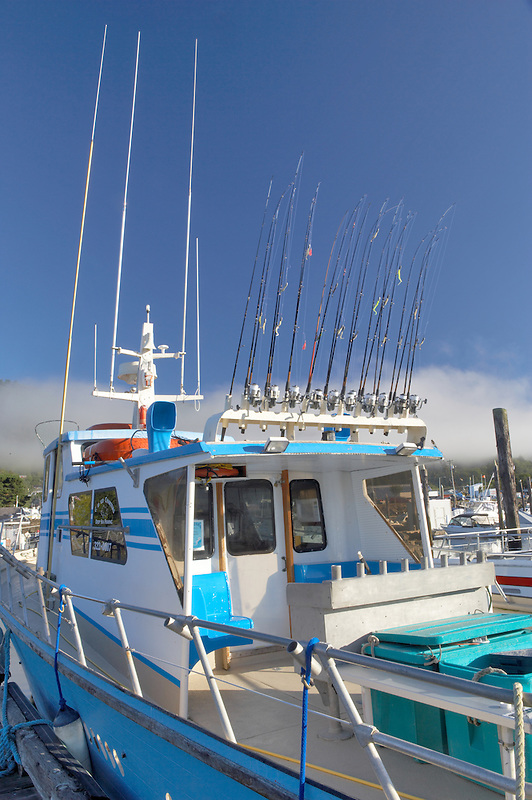Fishing poles on sport fishing boat. Garibaldi boat harbor. Oregon
