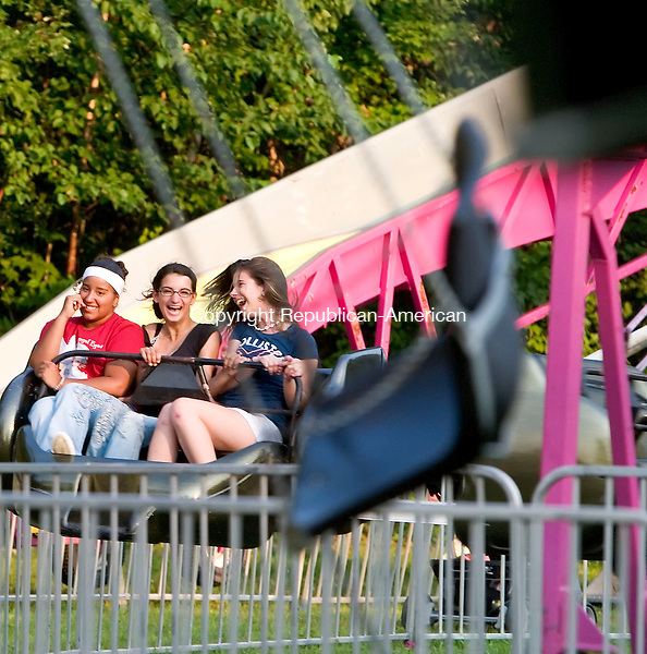 WATERBURY, CT- 02 AUG 2007- 080207JT06- <br /> From left, Paola Navarro, 14, Julia Kish, 16, and Angela Fidanza, 14, all of Watertown, enjoy a ride at the Pontelandolfo Club in Waterbury on Thursday during the first day of the 21st annual Festa di san Donato celebration.<br /> Josalee Thrift / Republican-American