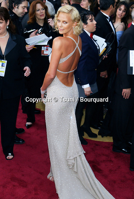 Charlize Theron arriving at the 76th Academy Awards - Oscars 2004 - at the Kodak Theatre in Los Angeles. February 29, 2004.