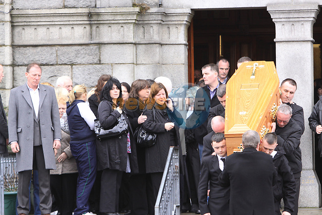 The remains of Seamus McMahon being taken from the Church in Dundalk. .Picture Fran Caffrey/Newsfile.ie