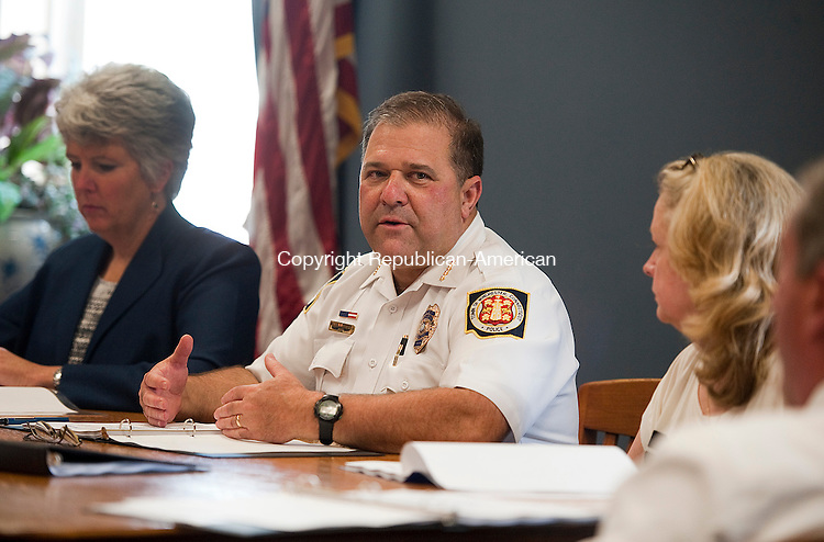 WINSTED, CT--- -090915JS06- Winsted police Chief William Fitzgerald, talks with other members of the Awards Committee during a meeting Wednesday at Winsted Town Hall. The committee is meeting to determine awards to members of the Winchester Department to be presented at a later date. <br /> Jim Shannon Republican-American