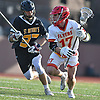 Sean Kuttin #17 of Chaminade, right, carries downfield during a Nassau-Suffolk CHSAA varsity boys lacrosse game against St. Anthony's at Chaminade High School on Wednesday, April 5, 2017. He scored twice in the third quarter. Chaminade won by a score of 12-6.